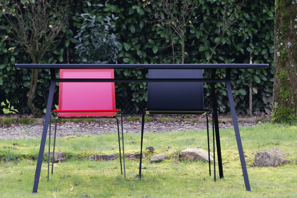 Indoor outdoor table minimalist black lacquered steel with fluorescent and black chairs