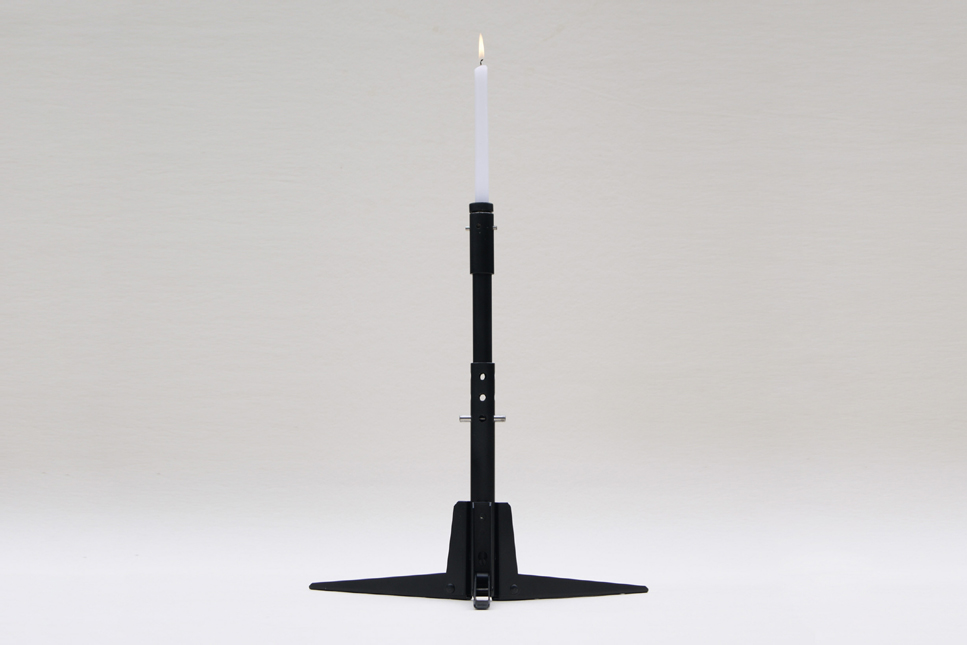 Dismountable candlestick in position one candle mimicking the aesthetic of a gun