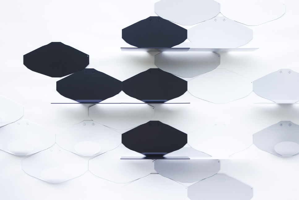 Modern minimalist wall shelves in white and gray lacquered black steel on a white background