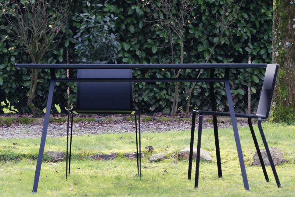 Indoor outdoor table minimalist black lacquered steel with black chairs
